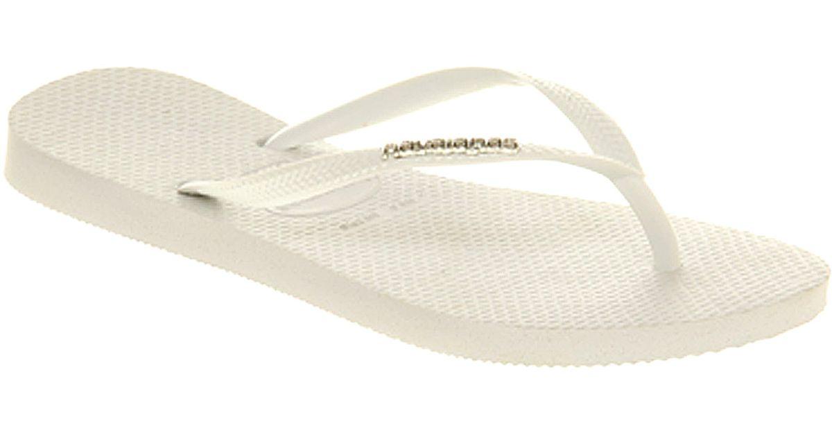 113c40575d159b Lyst - Havaianas Slim Logo Metallic in White