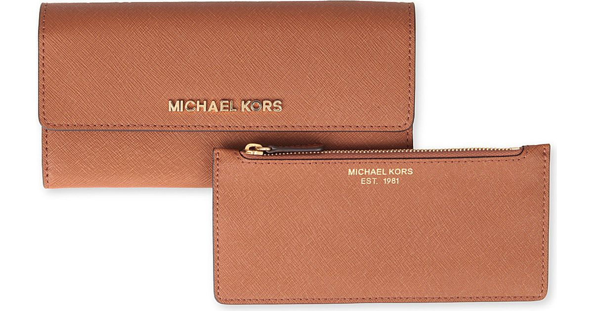 b40b19fc610f Michael Kors Michael Kors Saffiano Leather Trifold Wallet in Brown - Lyst