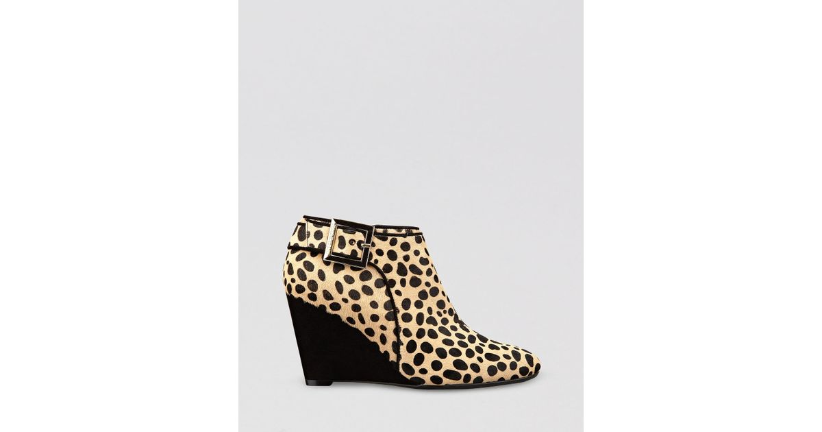 399a4a028bf Lyst - Isaac Mizrahi New York Wedge Booties Winona Leopard Print in Natural
