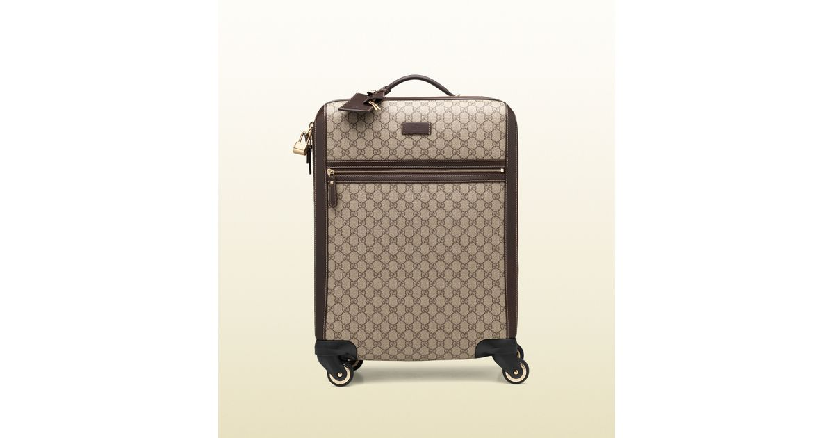 9379a73a03ab Gucci Gg Supreme Canvas Four Wheel Carry-on Suitcase in Natural for Men -  Lyst