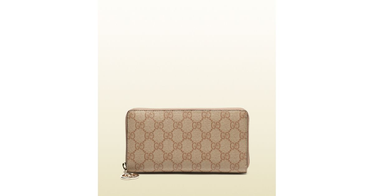 0ac64476f0b6 Gucci Gg Supreme Canvas Zip Around Wallet in Natural - Lyst