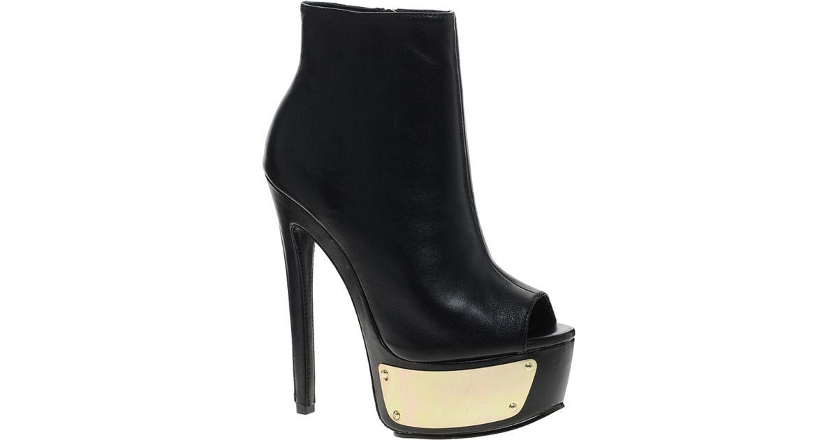 b1a88db9f9e4 Lyst - Steve Madden Sloann Peep Toe Leather Platform Ankle Boots in Black