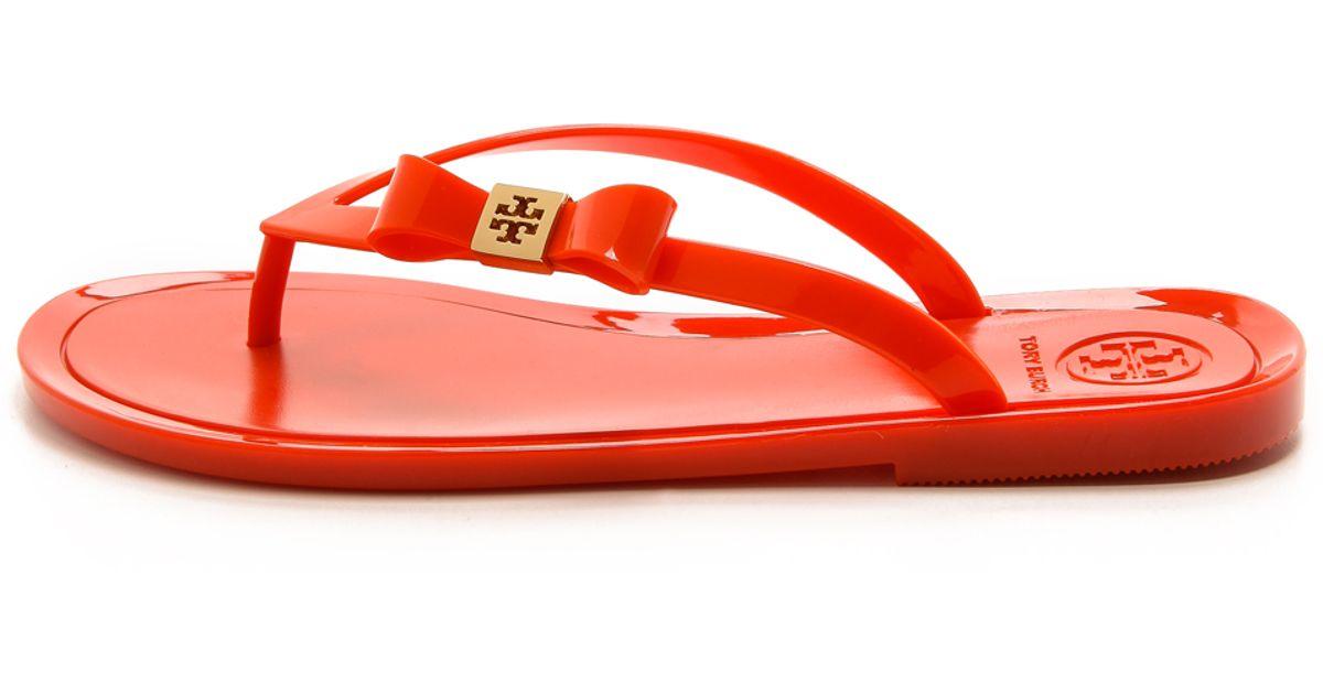 cbe5b560324d1 Tory Burch Michaela Bow Jelly Flip Flops - Dark Fuchsia in Orange - Lyst