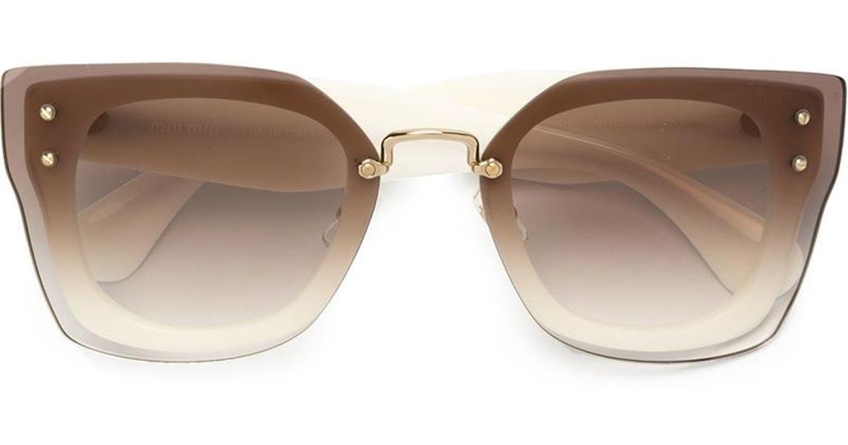 98b1e5bcb8b Lyst - Miu Miu  reveal  Sunglasses in Brown