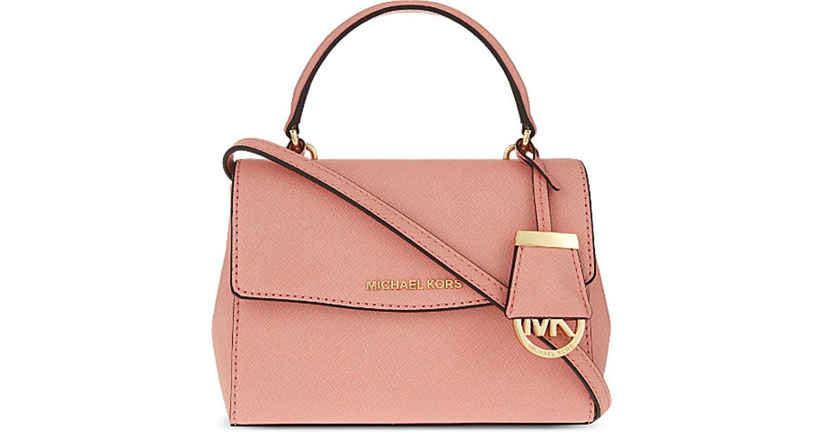 2197f87b890e MICHAEL Michael Kors Ava Extra Small Saffiano Leather Cross Body Bag in  Pink - Lyst