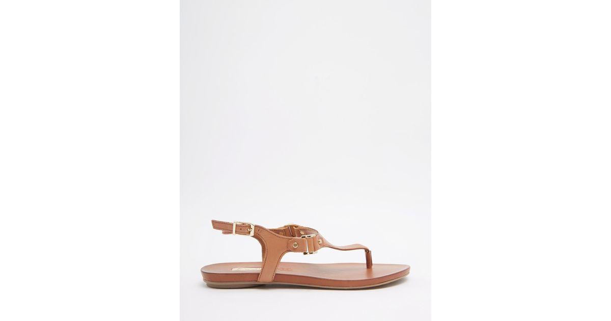 58ac380acb3 Lyst - ALDO Ldo Ashley Cognac Ankle Fastener Thong Sandals in Brown