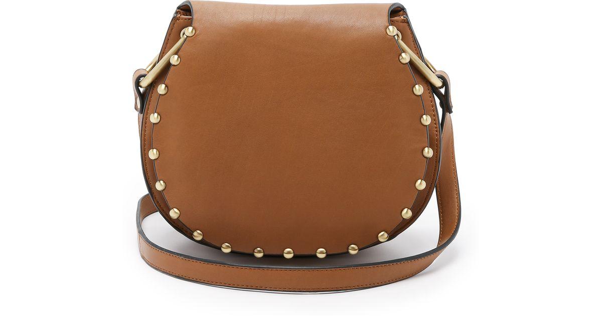 Lyst Cynthia Rowley Tabitha Cross Body Saddle Bag In Brown 7061f356584a4
