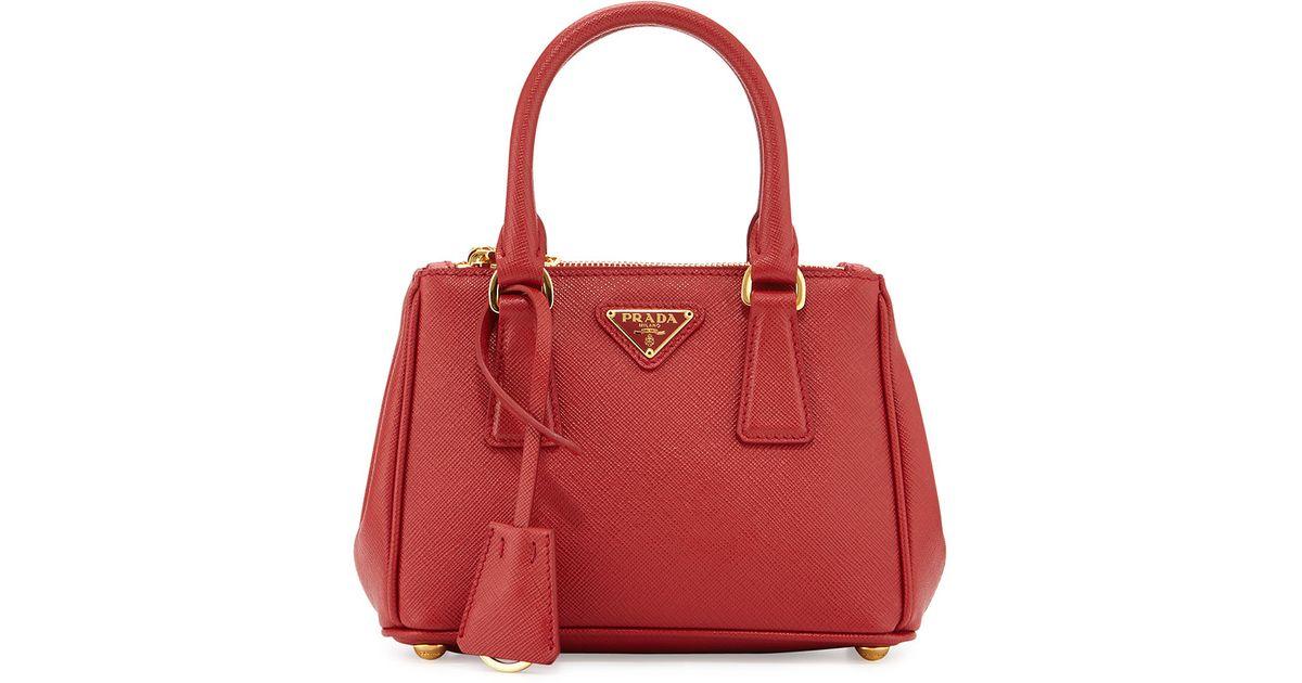 164605526e65 Prada Saffiano Extra-mini Executive Leather Bag in Red - Lyst