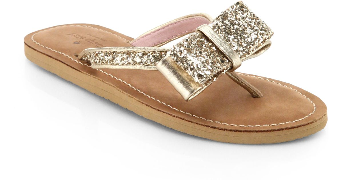 1314d16f9 Lyst - Kate Spade Icarda Glittered Leather Bow Thong Sandals in Metallic