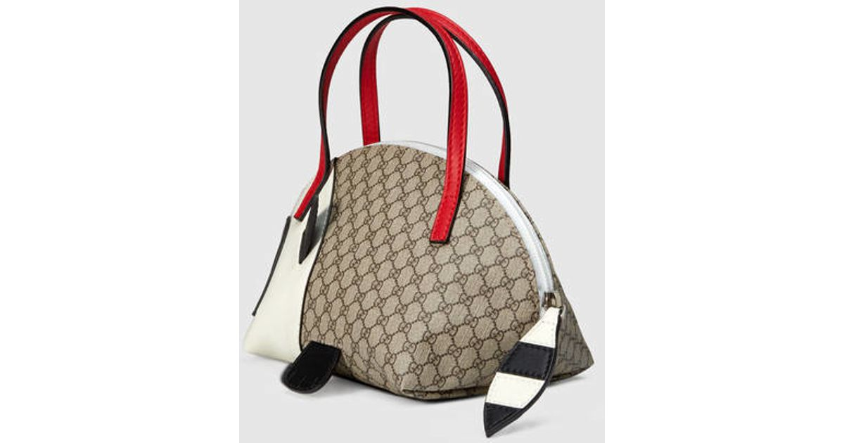 8f3f9bc54de0 Gucci Children's Gg Supreme Raccoon Bag in Red - Lyst