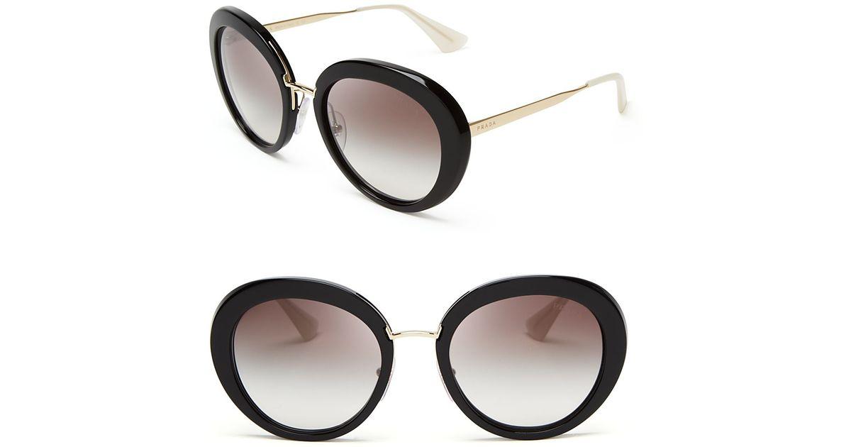 daa9b347a4cd ... sweden lyst prada round oversized sunglasses in black 395ed 764f0
