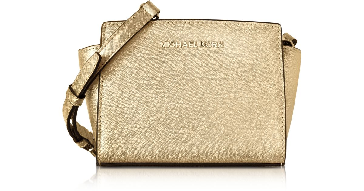 4cda61a11ef2 Michael Kors Pale Gold Metallic Saffiano Leather Selma Mini Messenger Bag  in Metallic - Lyst