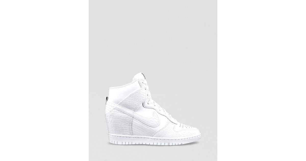 lowest price abd37 4ad0b Nike High Top Wedge Sneakers Womens Dunk Sky Hi in White - Lyst