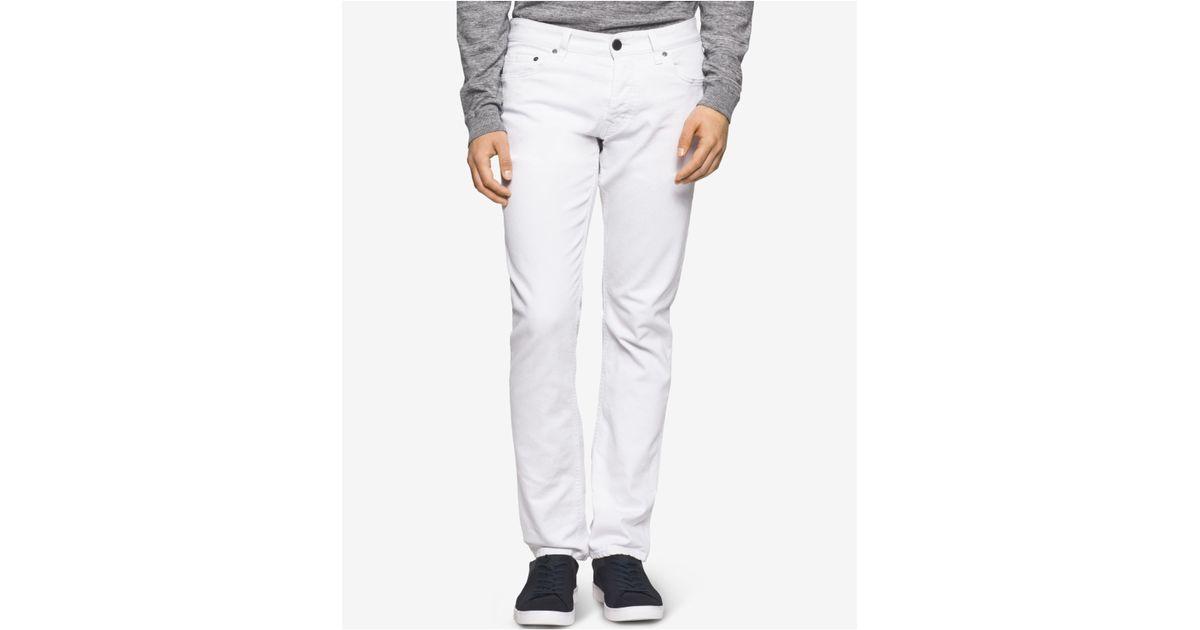 calvin klein jeans men 39 s slim straight fit jeans in white. Black Bedroom Furniture Sets. Home Design Ideas