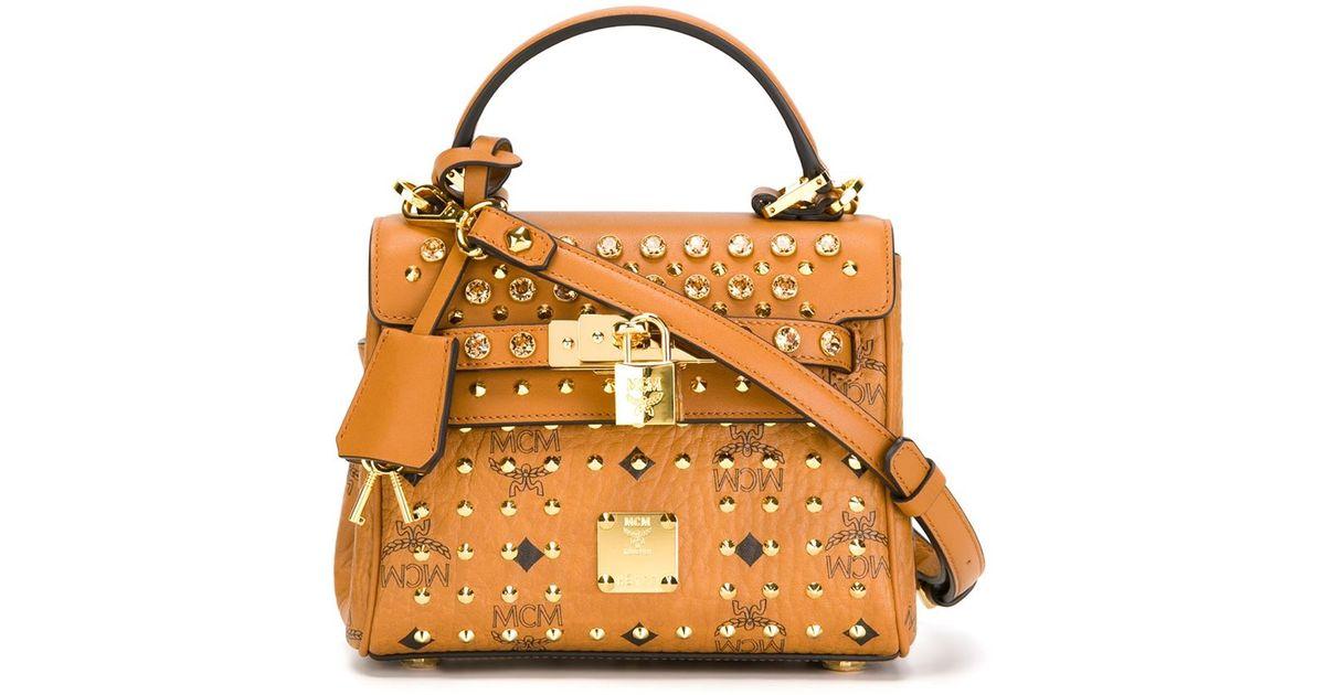 50496453b MCM Mini Studded Crossbody Bag in Orange - Lyst