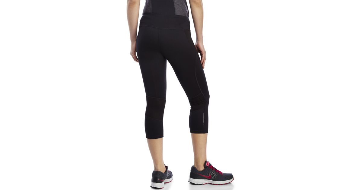 Reebok Skinny Capri Pants in Black | Lyst