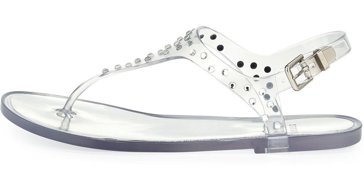 6a6b898f86b37 Lyst - Stuart Weitzman Glotacks Embellished Jelly Sandal in Metallic