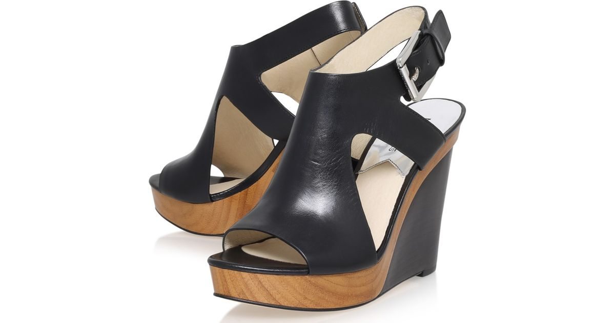 4adcc22053be Michael Michael Kors Josephine Wedge Heeled Sandals in Black - Lyst