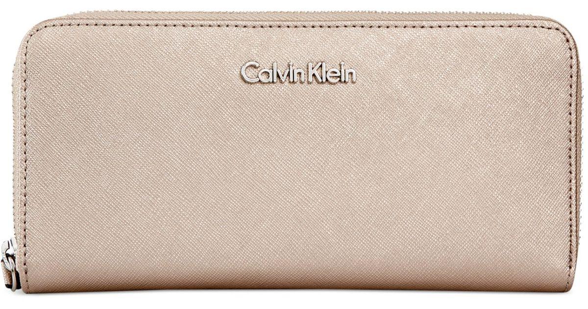 6ad991425e4 calvin klein saffiano leather zip around wallet Lyst - Calvin Klein Saffiano  Zip Around Wallet in Brown