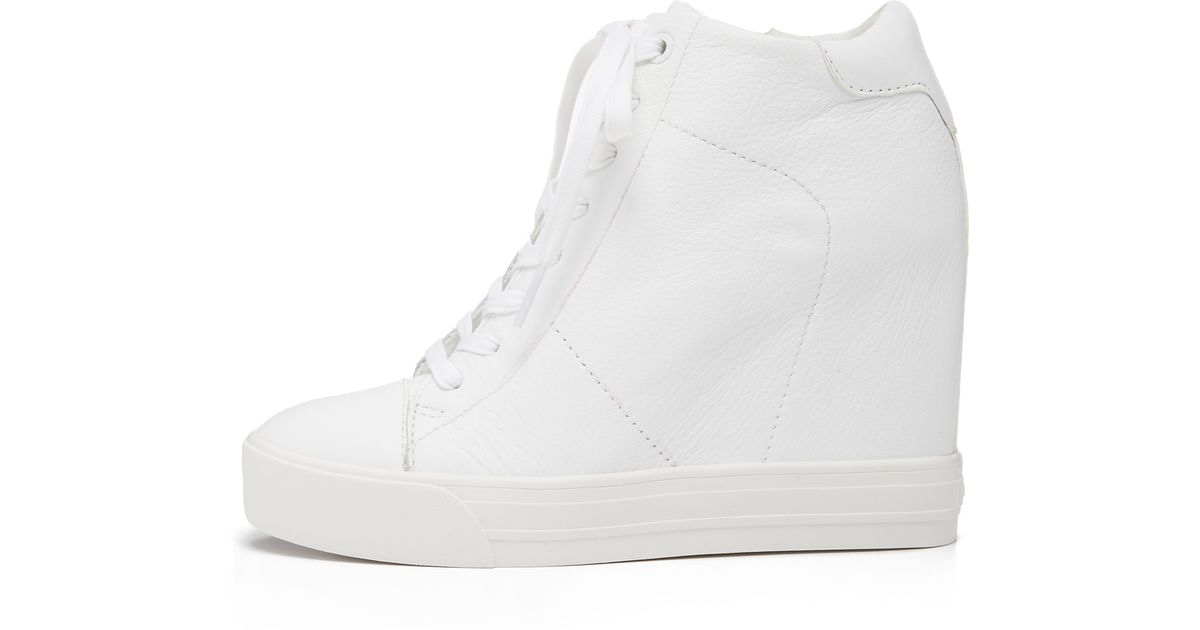 4ba81dcc5e5d DKNY Ginnie Wedge Sneakers in White - Lyst