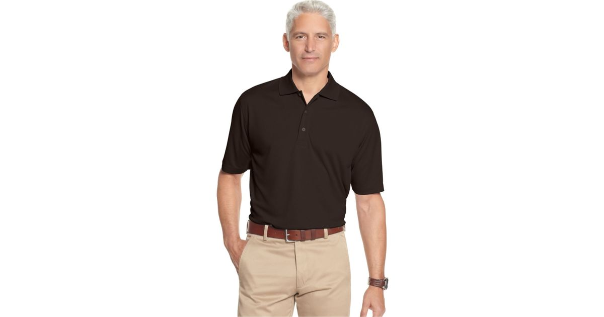 Izod men 39 s performance golf polo in black for men lyst for Izod big and tall essential solid shirt