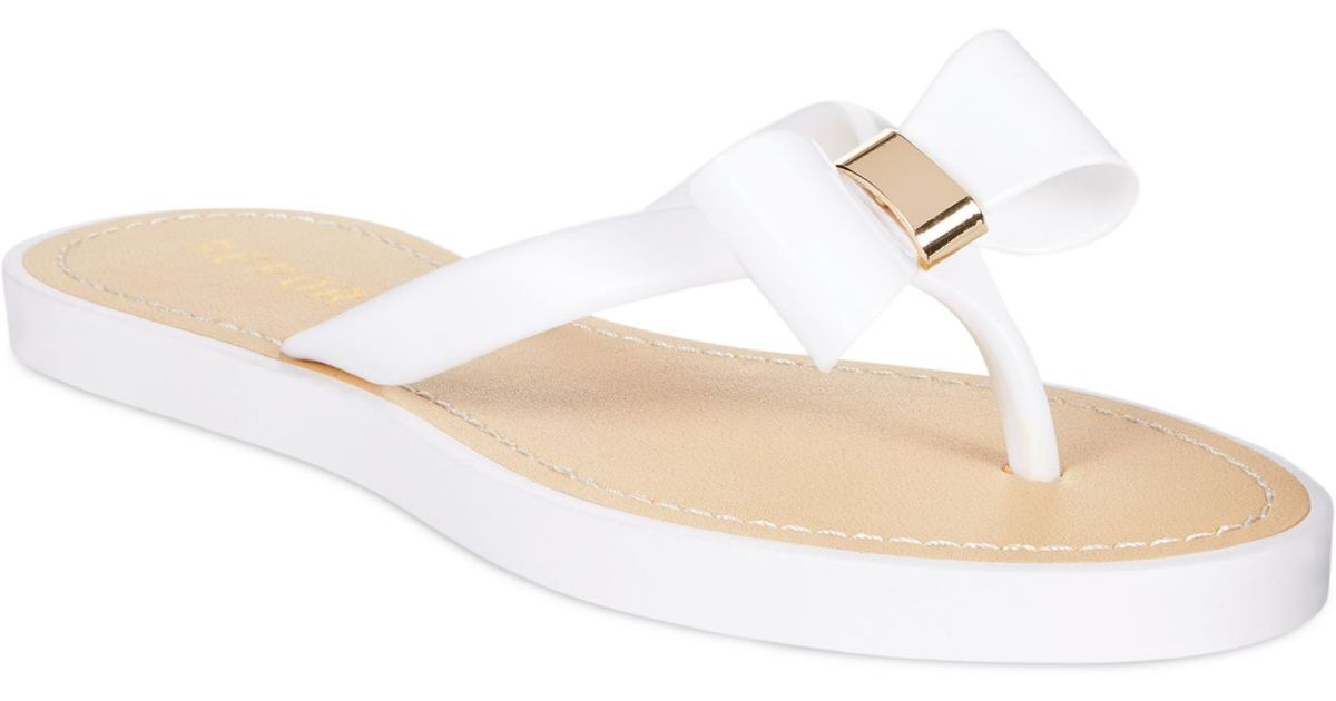 a5a2cd707 Lyst - Report Jenski Flat Bow Thong Sandals in White