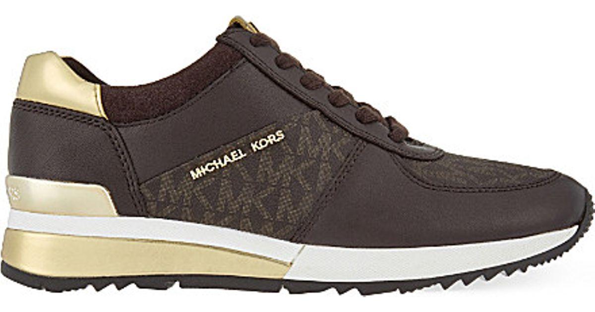 e31929dec4c17 Lyst - MICHAEL Michael Kors Allie Wrap Leather Trainers in Black
