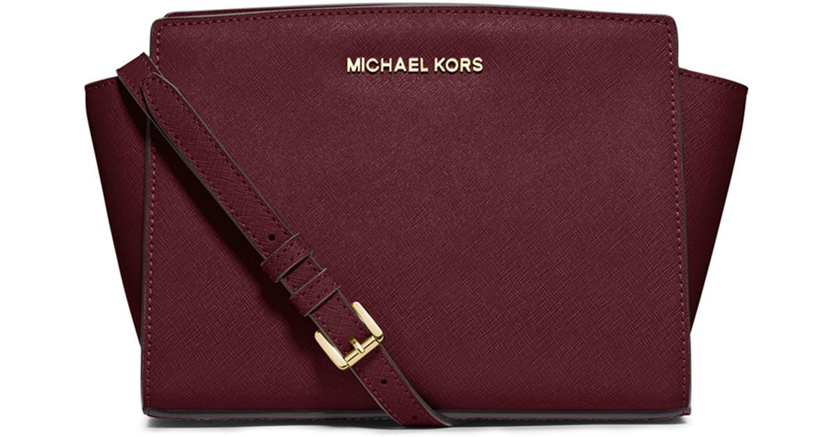 4fe2eb9cea30 ... cheapest lyst michael michael kors selma medium leather messenger bag  in purple 1d18e 98ac7