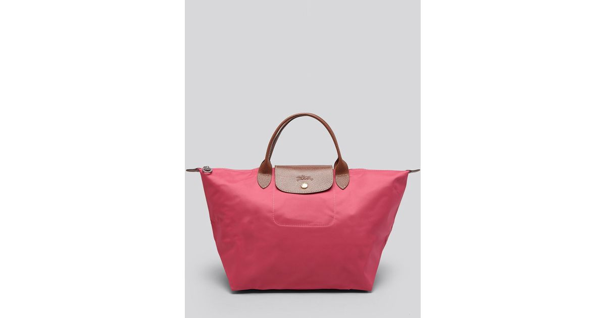e4c39c04e69 Lyst - Longchamp Tote - Le Pliage Medium Handheld in Pink