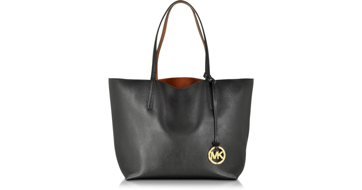 cbad2a614945 ... inexpensive michael kors izzy large reversible leather tote in black  lyst d8821 33ca7
