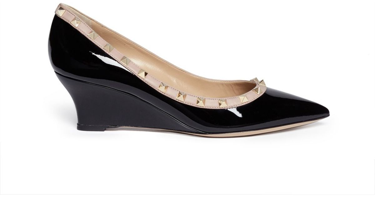 3210fbbe94e Lyst - Valentino  rockstud  Patent Leather Wedge Pumps in Black