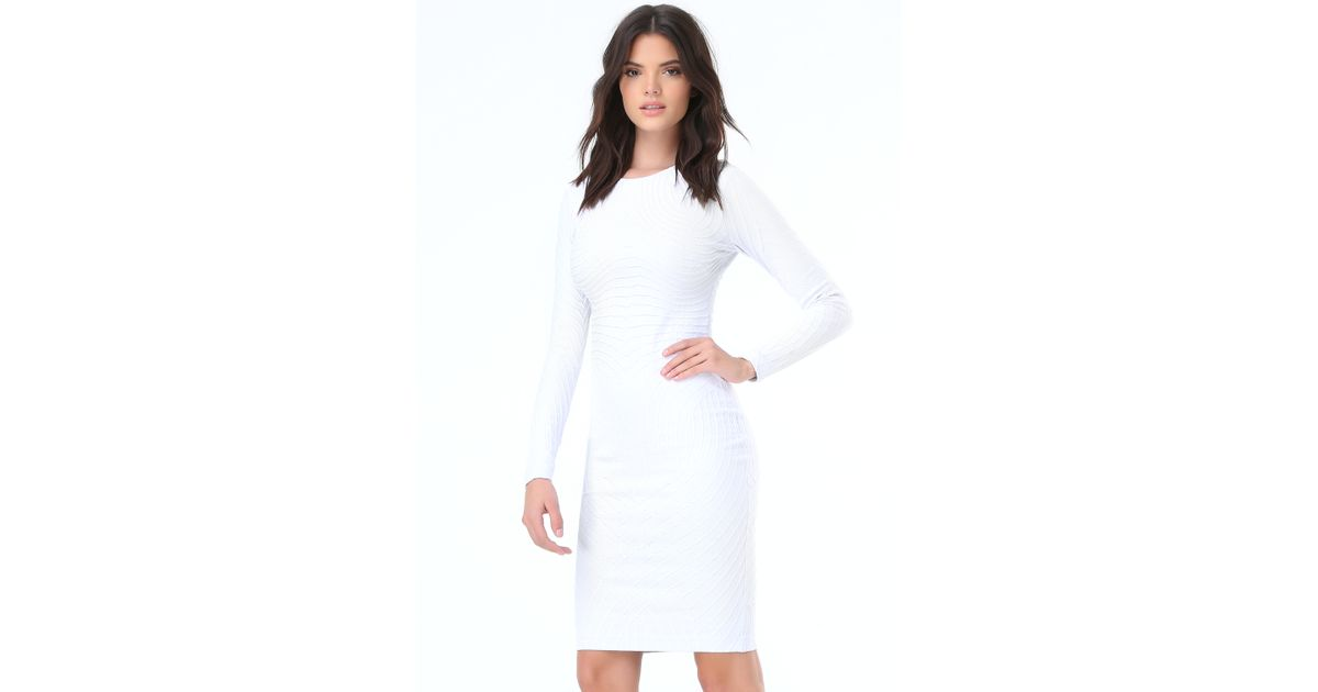5800262fa162 Lyst - Bebe Textured Midi Dress in White