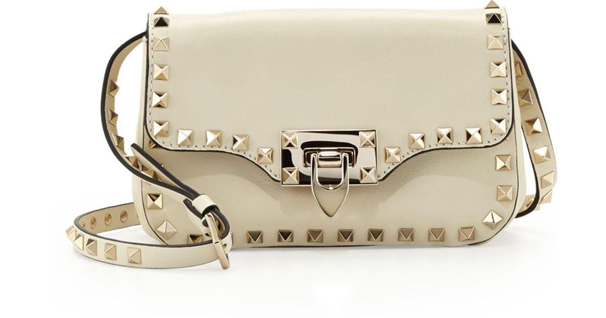Lyst - Valentino Rockstud Mini Crossbody Bag in White 053e248699c5d