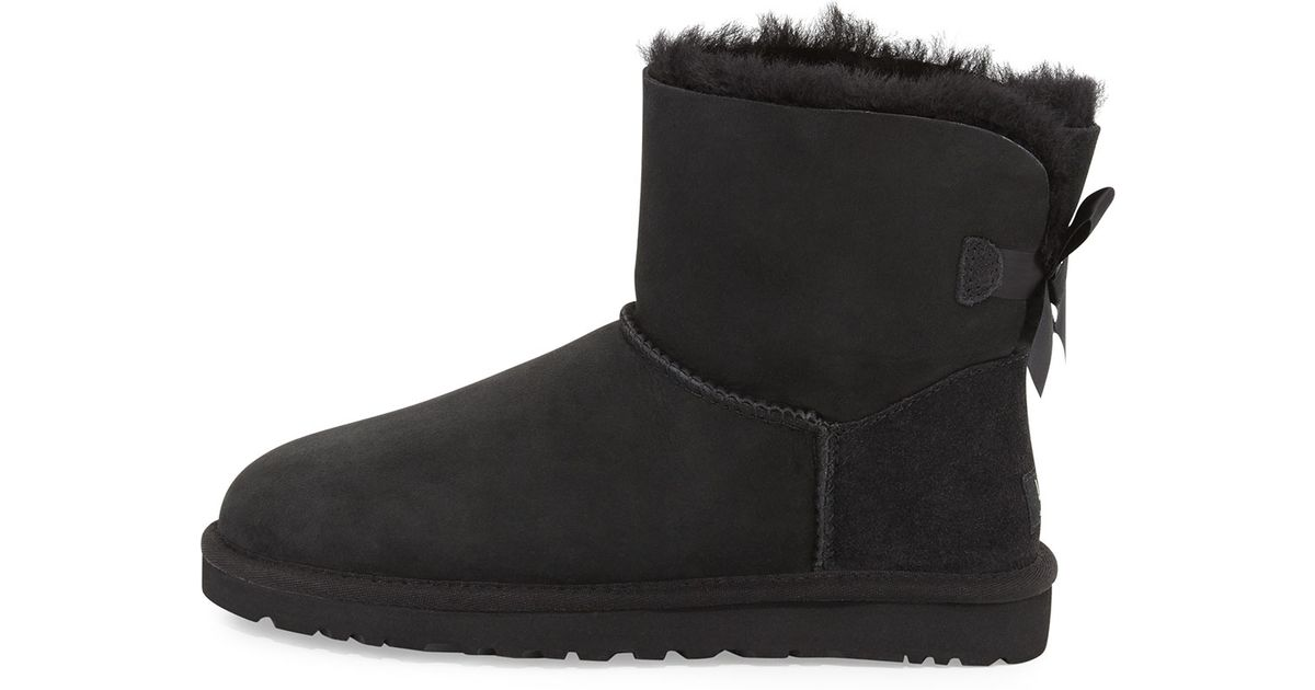 ugg mini bailey bow-back boot in black - lyst