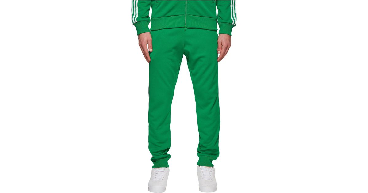 6770a9cdc9d9 Lyst - adidas Originals Sst Track Pants in Green for Men