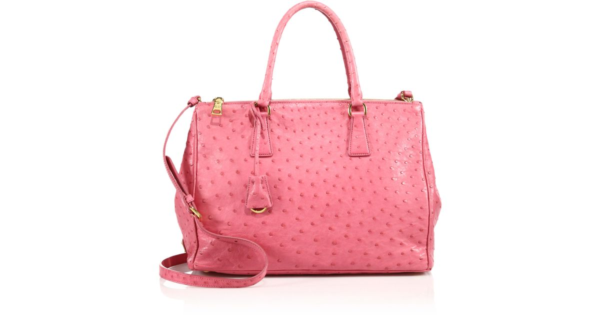 69766efa4a5a ... bag for sale b2fd0 6e853; inexpensive lyst prada ostrich double zip  tote in pink 09603 eb8e6
