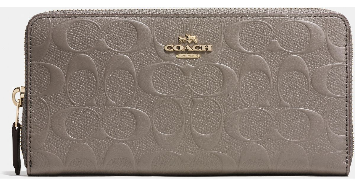ff68ab235d Lyst - COACH Accordion Zip Wallet In Signature Embossed Leather in Metallic