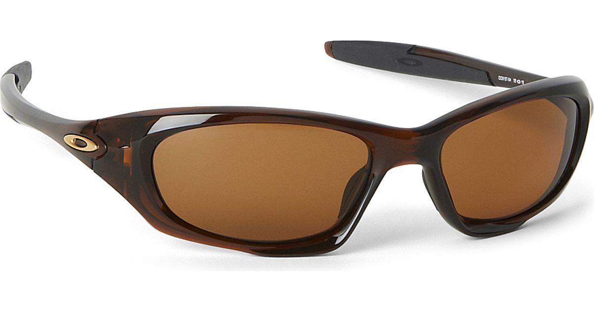 230dc70e20d Oakley Twenty Polarized Wraparound Sunglasses - For Men in Blue for Men -  Lyst