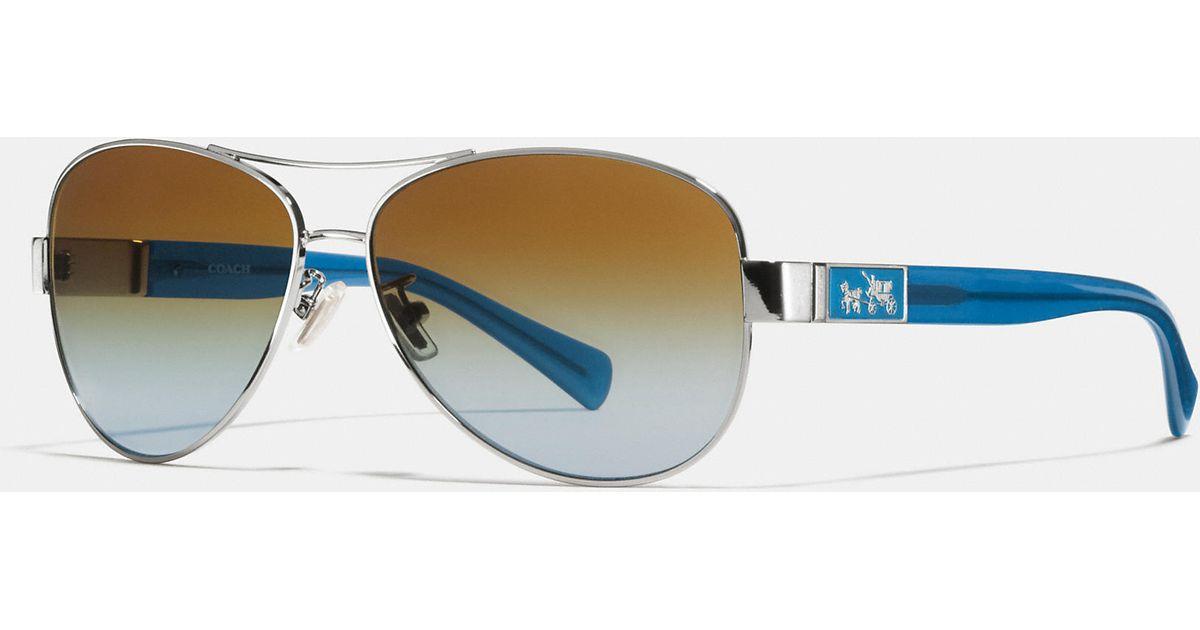 009c565166c ... cheap lyst coach christina polarized sunglasses in blue 0d7b7 9a480 ...