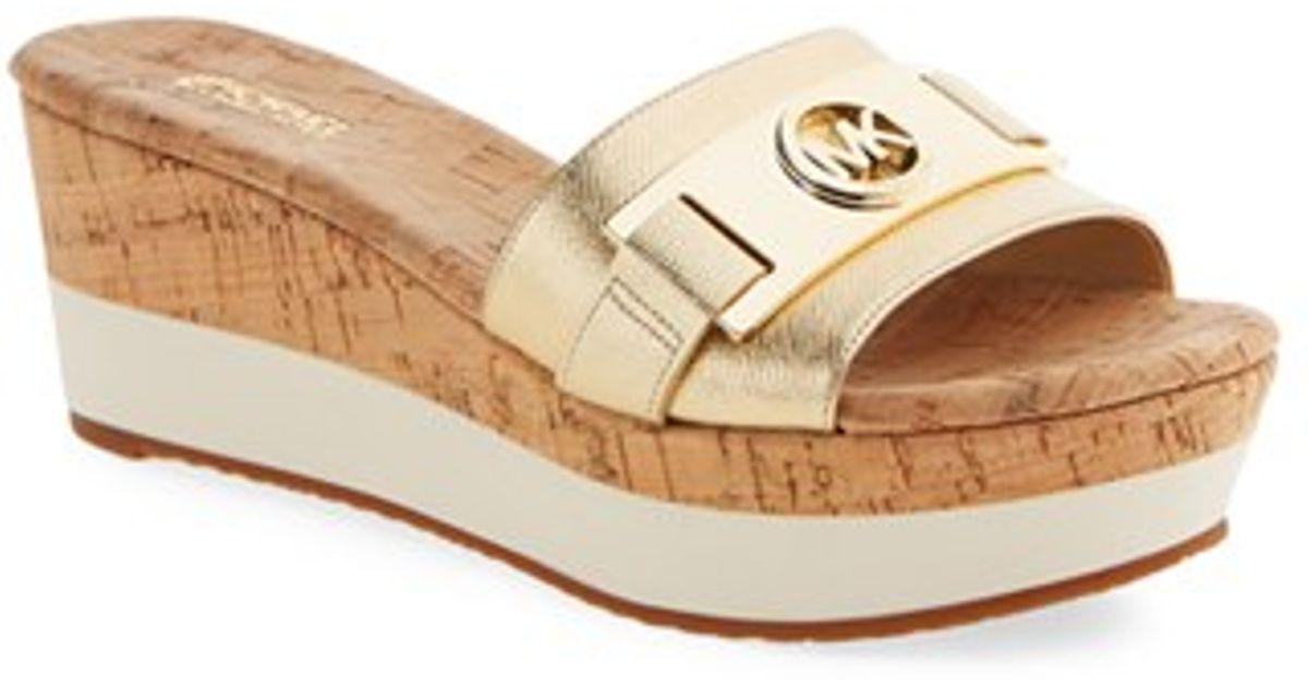 631e39976de Lyst - MICHAEL Michael Kors Warren Platform Sandals in Metallic