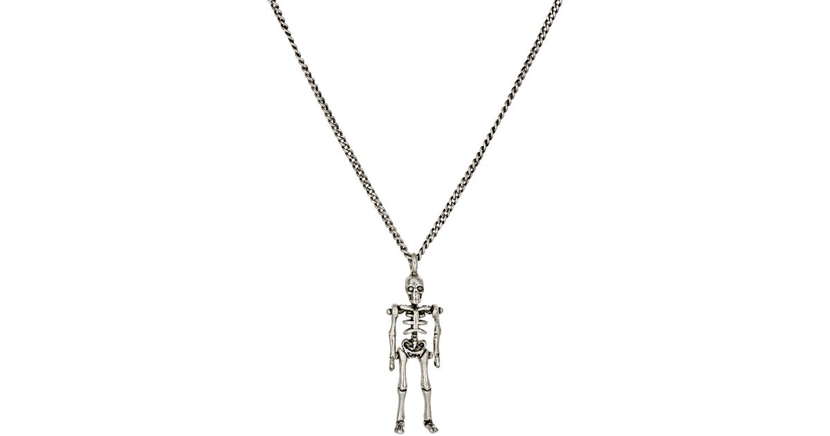 Lyst saint laurent punk skeleton pendant necklace in gray aloadofball Image collections