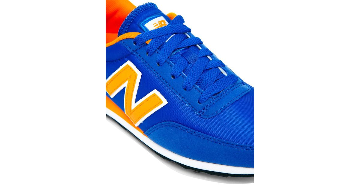 new balance blue yellow 410 trainers