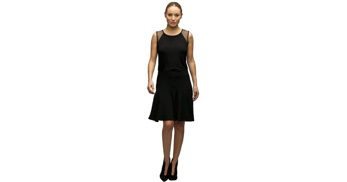 komarov knee length flared skirt in black lyst