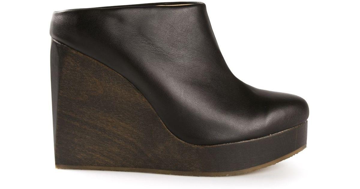 c765072649fa Lyst - Sydney Brown Wedge Clogs in Black