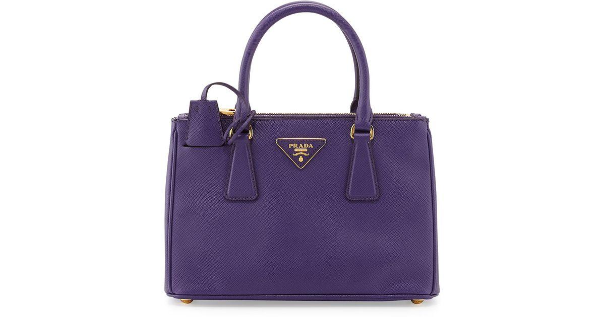 fcbbe0cea2e9 coupon for lyst prada saffiano double zip mini crossbody in purple 6a03b  83475