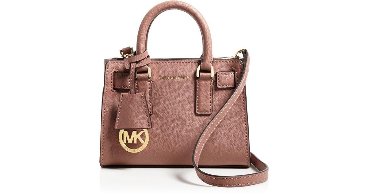 73ba00abbd4c ... uk lyst michael michael kors dillon mini leather cross body bag in pink  34089 09def