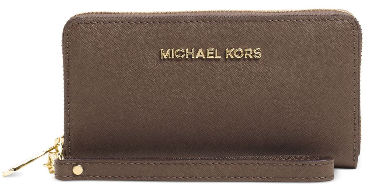 0fcd91c7c744c4 Michael Kors Michael Jet Set Travel Large Coin Multifunction Phone Case in  Brown - Lyst