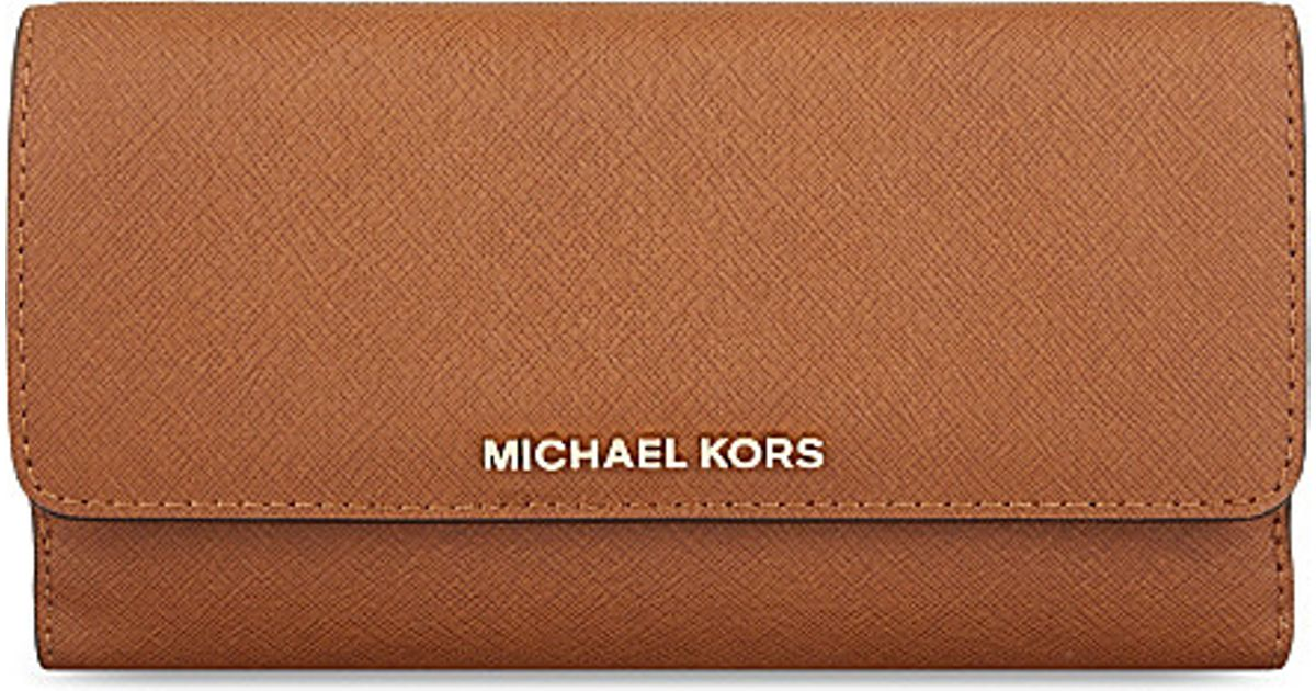 1d7a97b20990e2 MICHAEL Michael Kors Jet Set Tri-fold Saffiano Leather Wallet in Brown -  Lyst