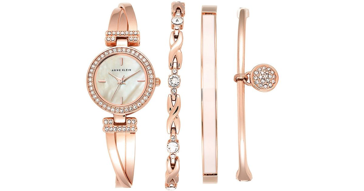 Anne klein four piece bracelet watch set in pink lyst for Anne klein rose gold watch set