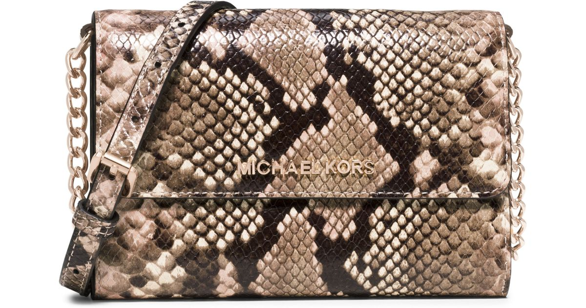 e03d9824fb4d ... italy lyst michael michael kors jet set python embossed smartphone  crossbody bag a306d b1055